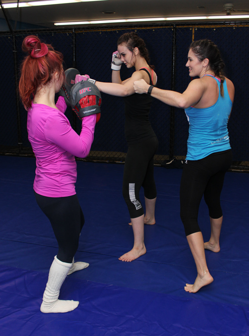 Women's Self-Defense class with women practicing punches