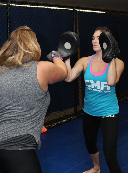 Women's Self-Defense class with students practicing boxing combos