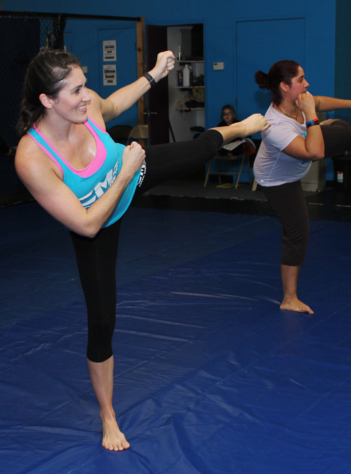 Students at a Women's Self-Defense class practicing high kicks
