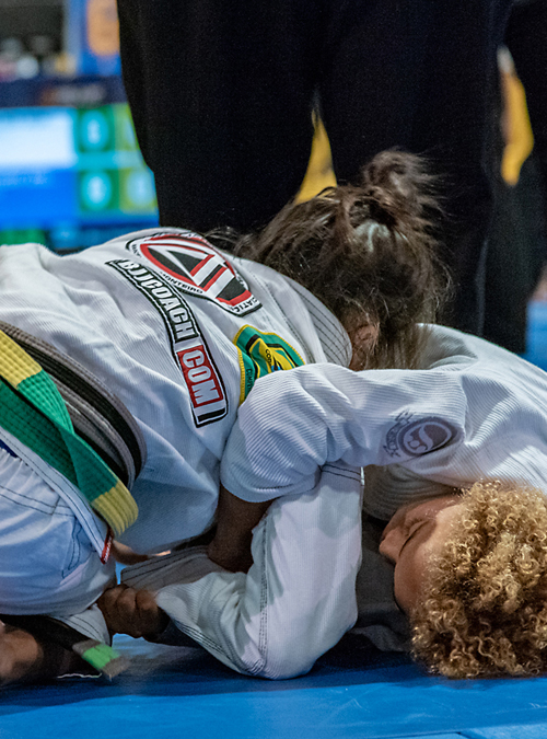Kid applying an armlock on opponent at the IBJJF American Nationals