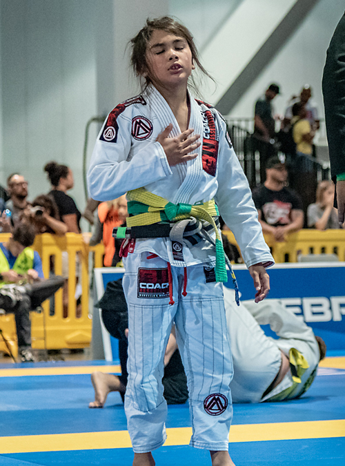 Young kid winning a Kid's Brazilian Jiu-jitsu tournament