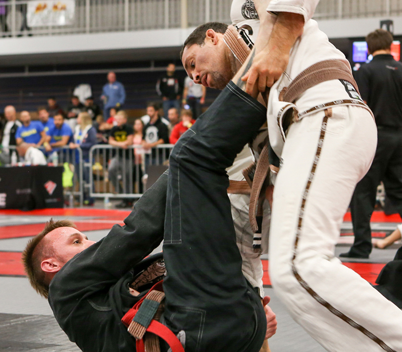 BJJ brown belts rolling at a Northwest Indiana grappling tournament