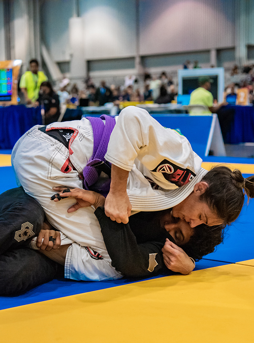 Women's Self-Defense instructor at a Brazilian Jiu-jitsu tournament